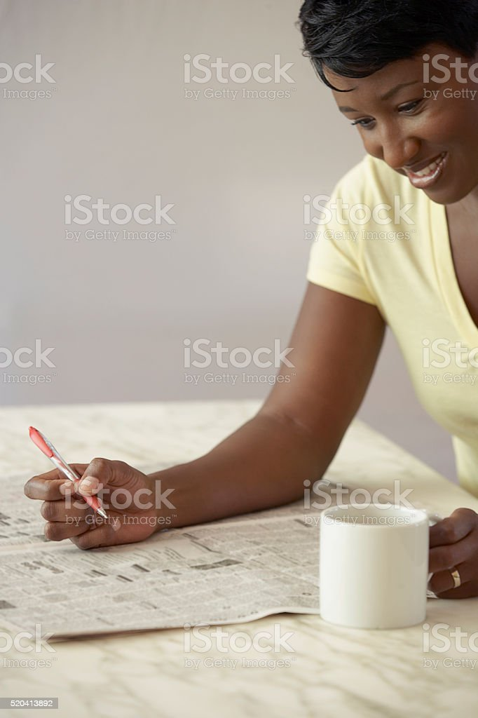 Woman reading newspaper stock photo