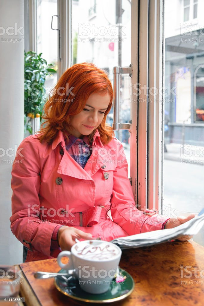 Woman reading newspapers stock photo