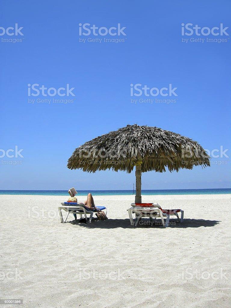 woman reading on beach royalty-free stock photo