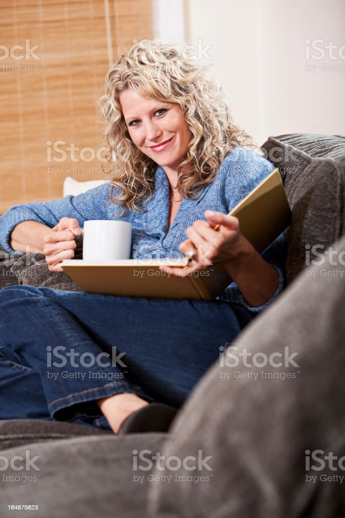 Woman reading on couch stock photo