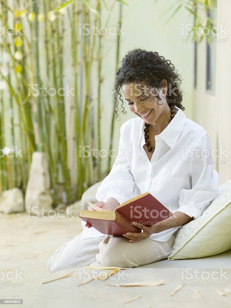Woman reading on patio royalty-free stock photo