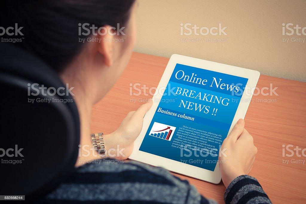 woman reading online news stock photo