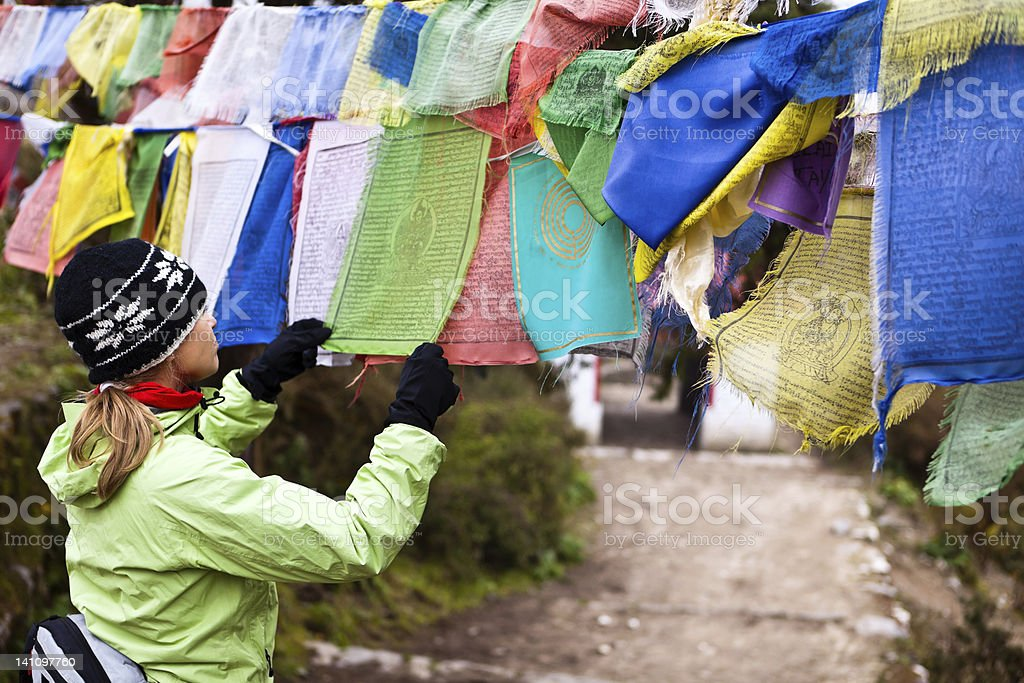 Woman reading prayers flag in Nepal royalty-free stock photo