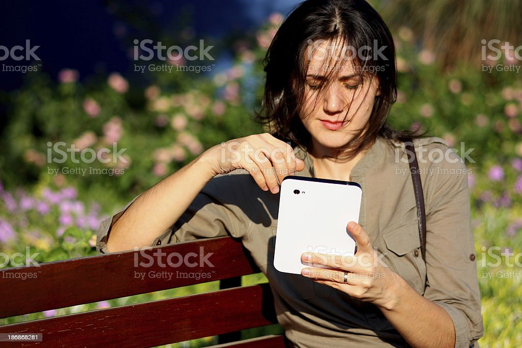 Woman reading text message outdoors royalty-free stock photo