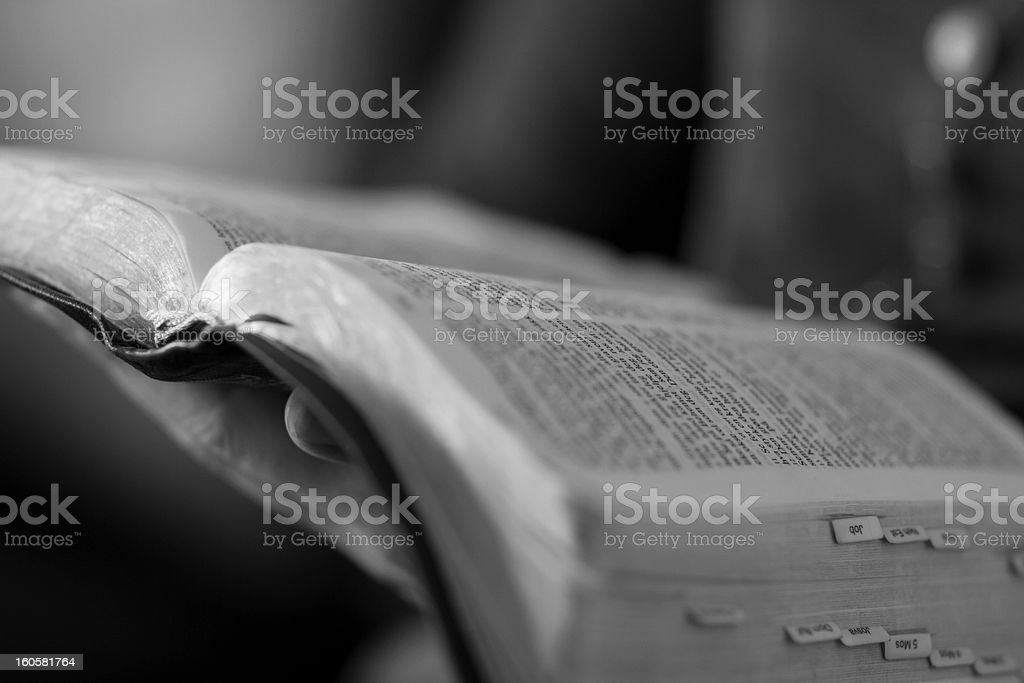 Woman reading the bible black and white stock photo