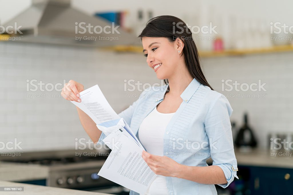 Woman reading the mail stock photo