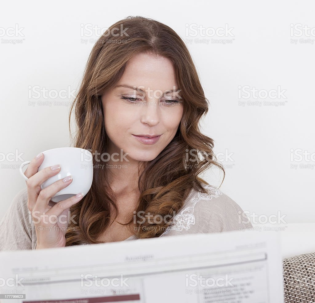 Woman reading the newspaper royalty-free stock photo