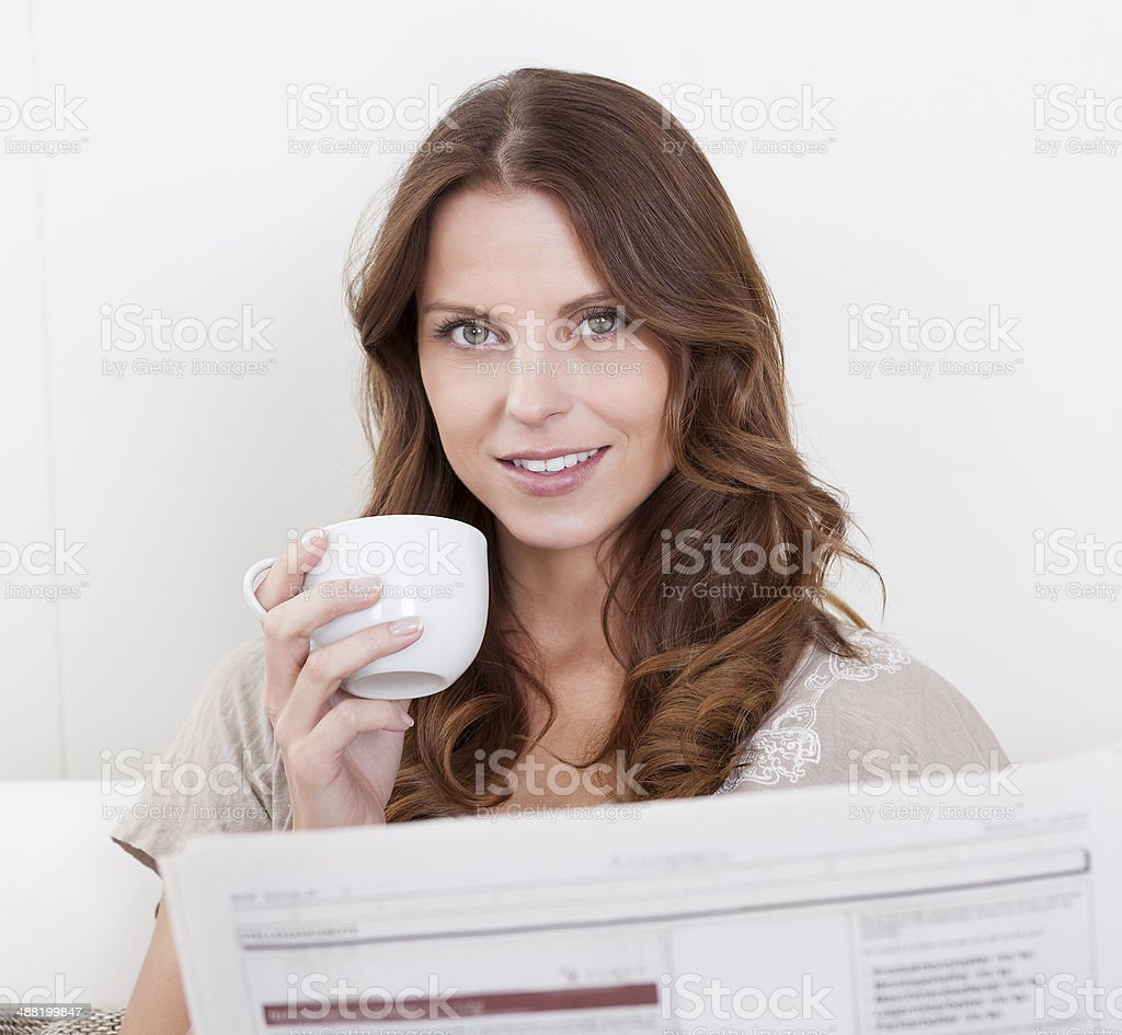 Woman reading the newspaper stock photo