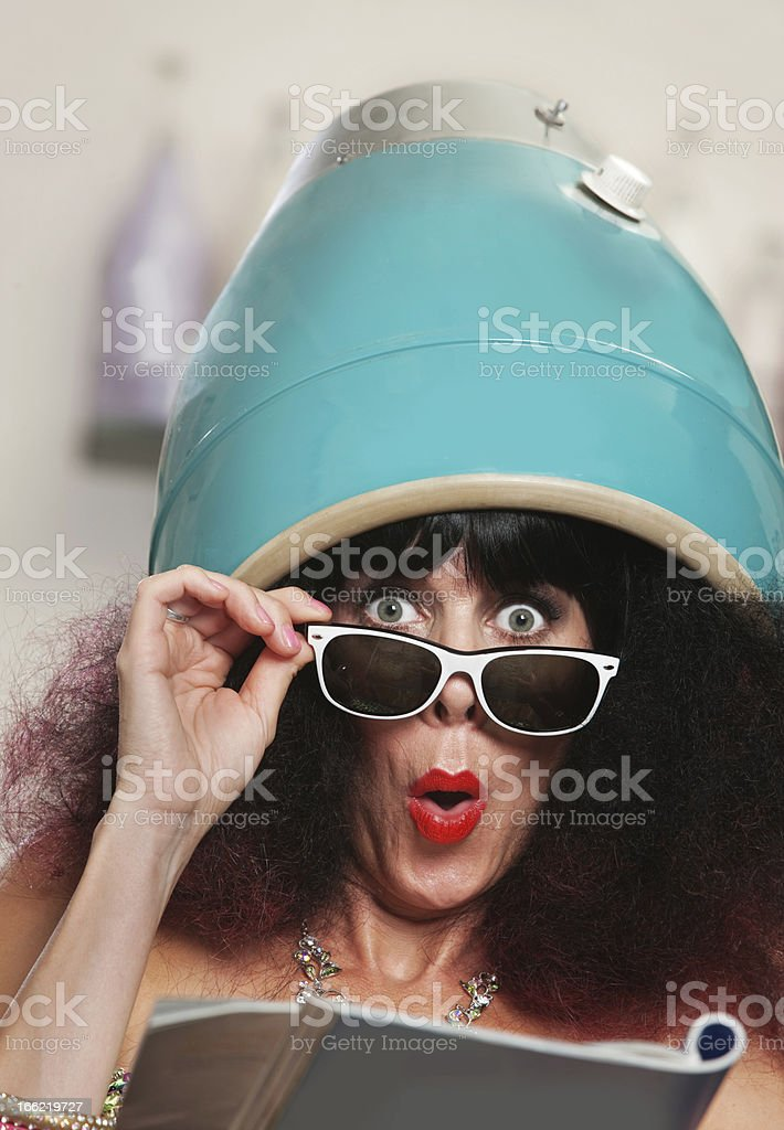 Woman Reading Under Hair Dryer royalty-free stock photo