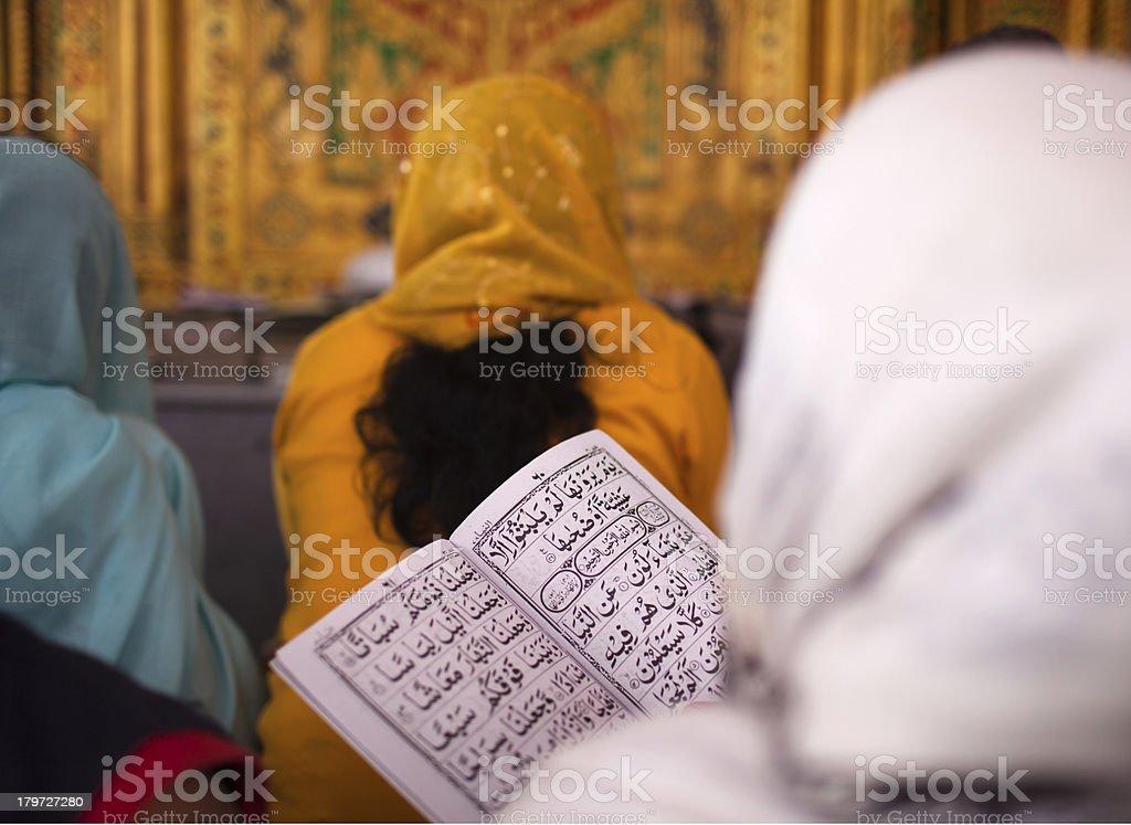 Woman reads Koran royalty-free stock photo