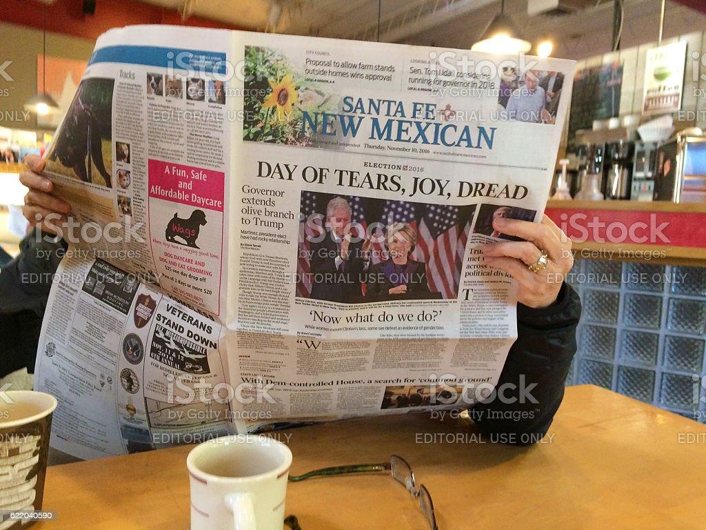 Woman Reads Newspaper with Headline: 'Day of Tears, Joy, Dread' stock photo