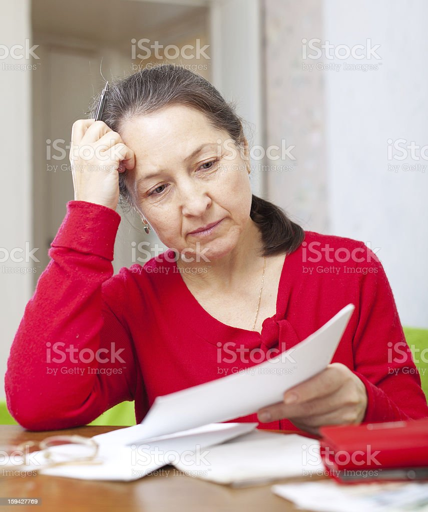 woman reads payments  at home royalty-free stock photo