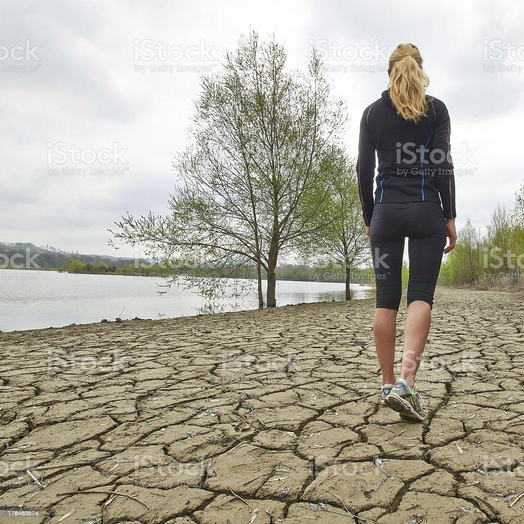 Woman ready for beach run stock photo