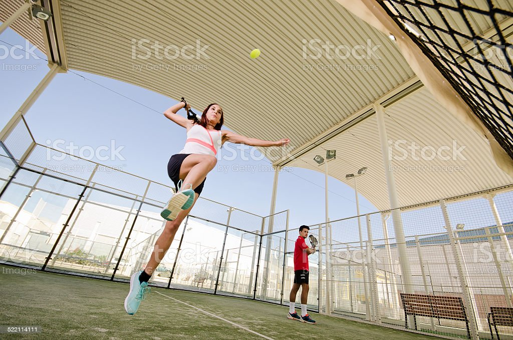 Woman ready for paddle tennis serve smash stock photo