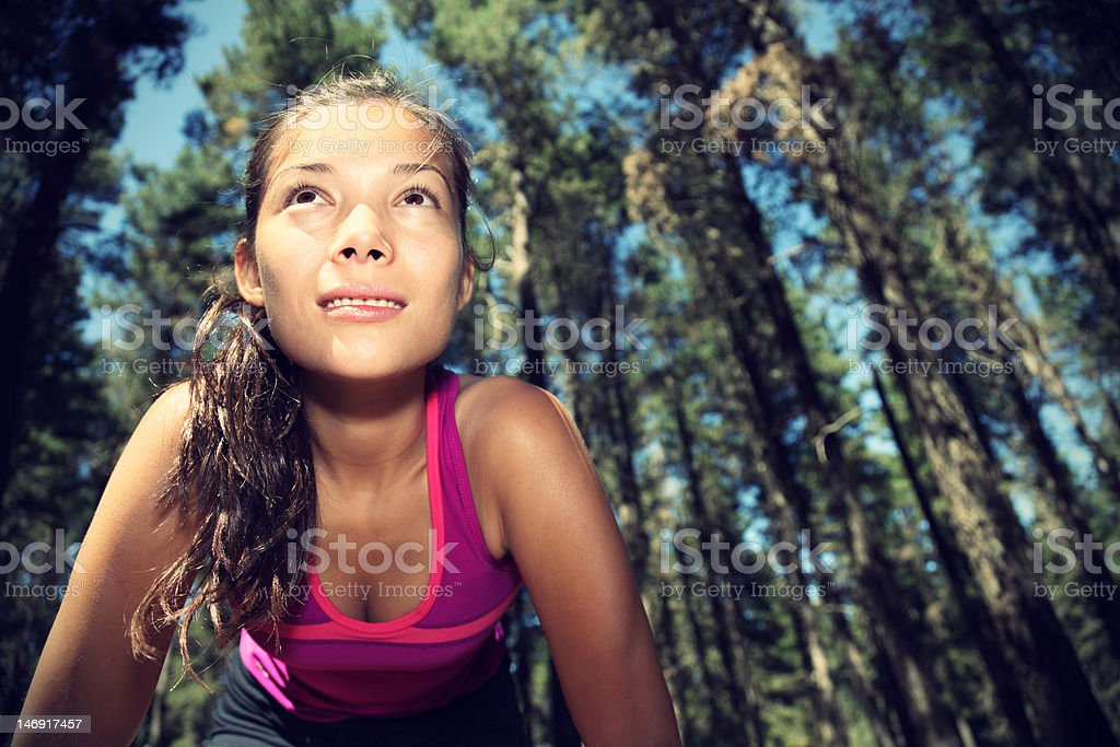 Woman ready to exercise in forest stock photo