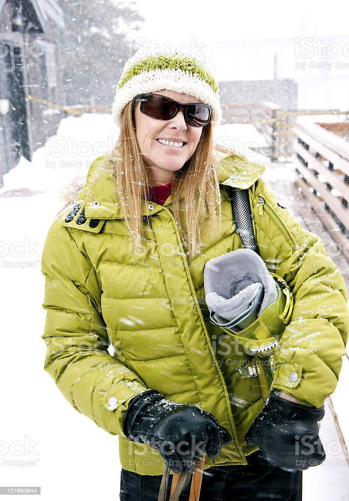 Woman Ready to Go Skiing stock photo