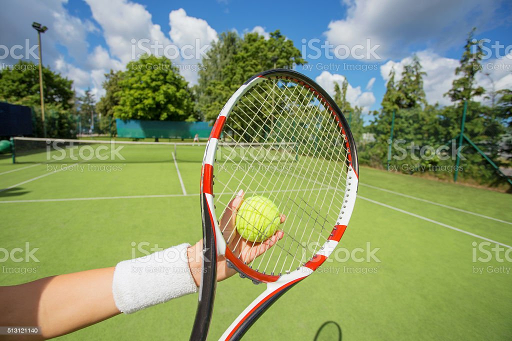 Woman ready to serve the tennis ball stock photo