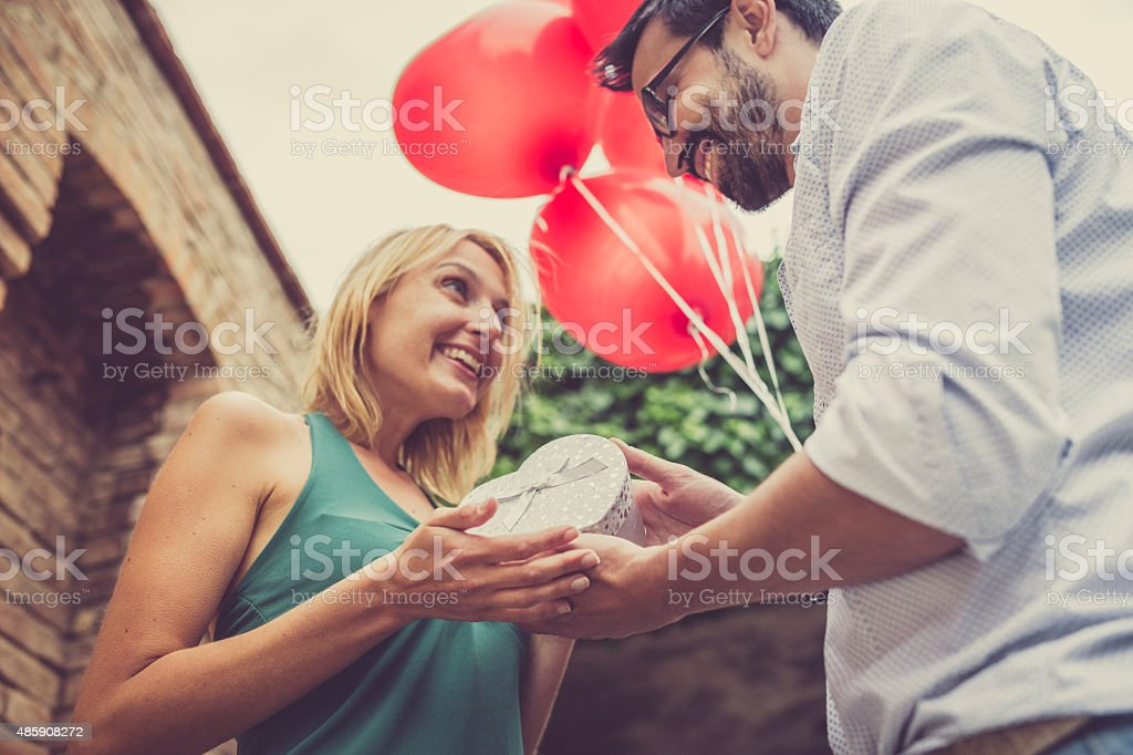 Woman receives a gift from her man stock photo