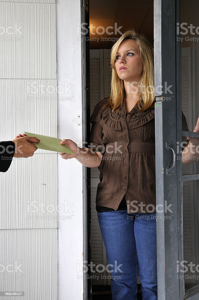 Woman Receives Hand-Delivered Document royalty-free stock photo