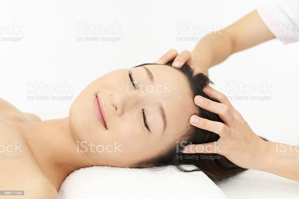Woman receives head massage stock photo