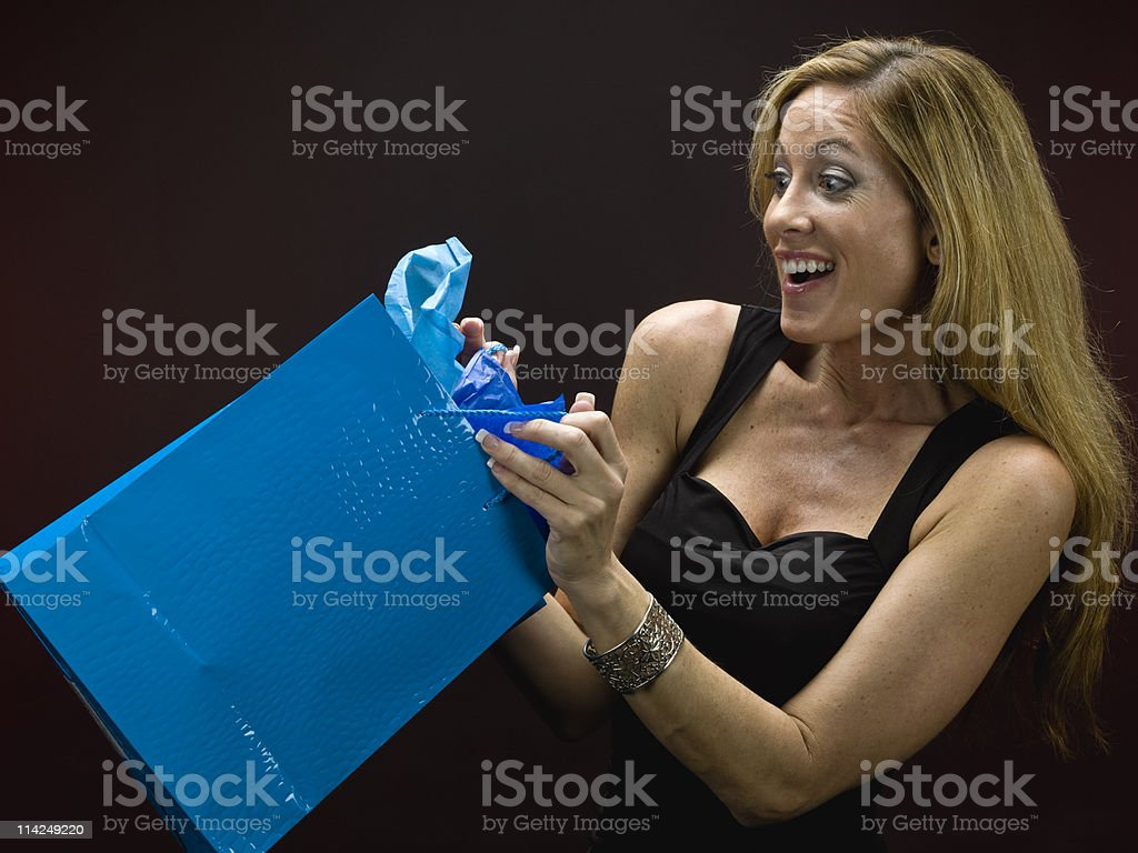 A woman receives the perfect gift stock photo
