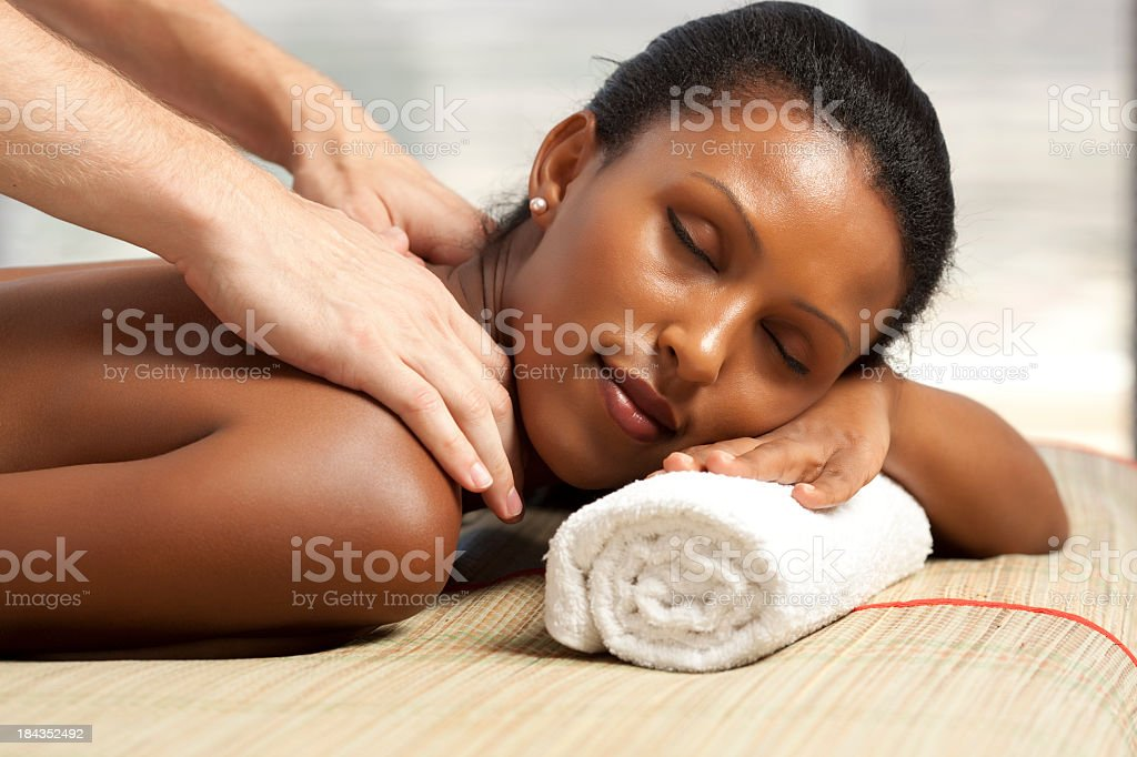 Woman receiving a back massage royalty-free stock photo
