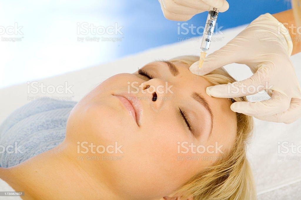 A woman receiving a Botox treatment  stock photo