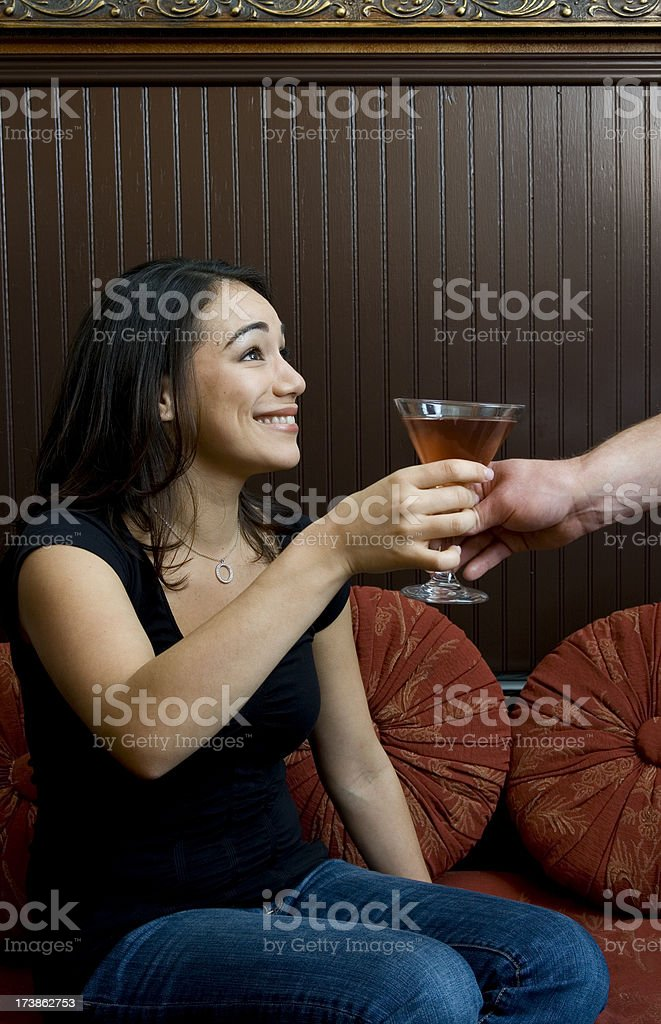 Woman Receiving a Cocktail stock photo