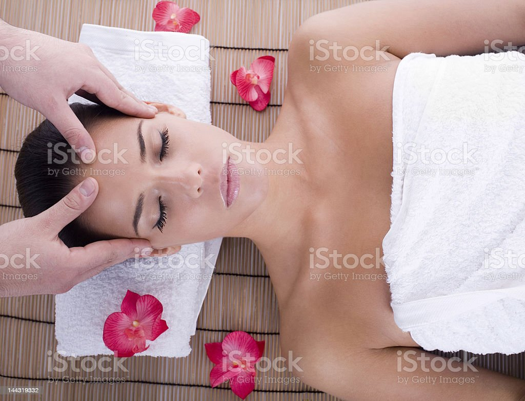 Woman receiving a facial massage at a spa royalty-free stock photo