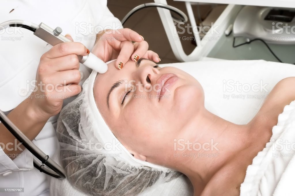 Woman receiving a facial prep for surgery royalty-free stock photo
