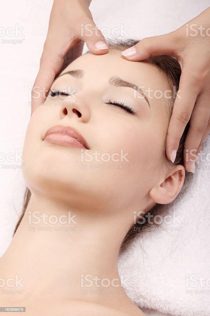 A woman receiving a head massage stock photo