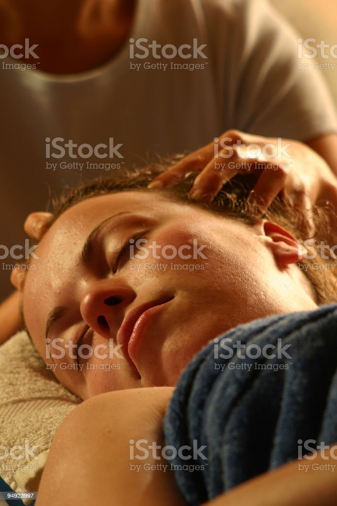 Woman receiving a head massage stock photo