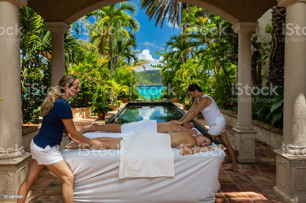 woman receiving a massage at a beautiful villa in Caribbean stock photo