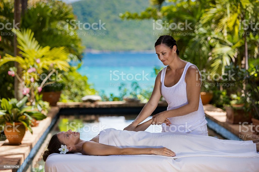 woman receiving a massage at a beautiful villa in Caribbean stock photo