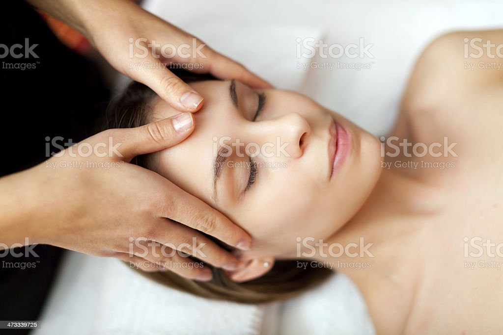 Woman receiving a massage stock photo