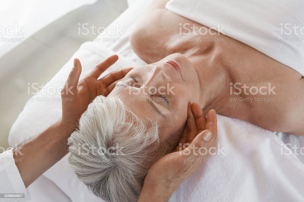 Woman Receiving a Massage stock photo