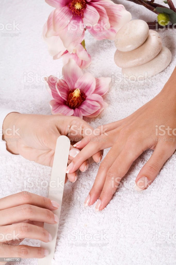 A woman receiving a nice manicure royalty-free stock photo