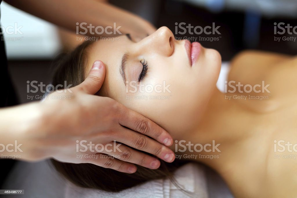 Woman receiving a temple massage stock photo