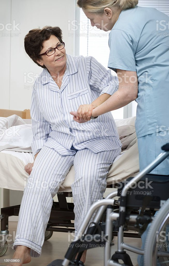 A woman receiving assistance in the hospital royalty-free stock photo