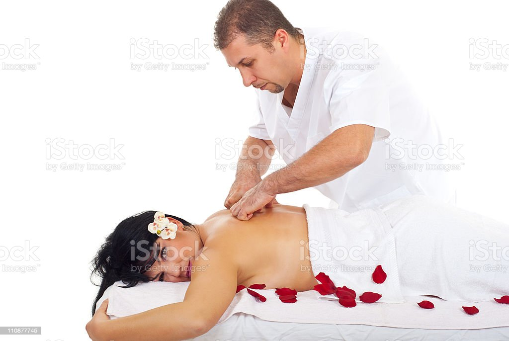 Woman receiving back massage at spa royalty-free stock photo