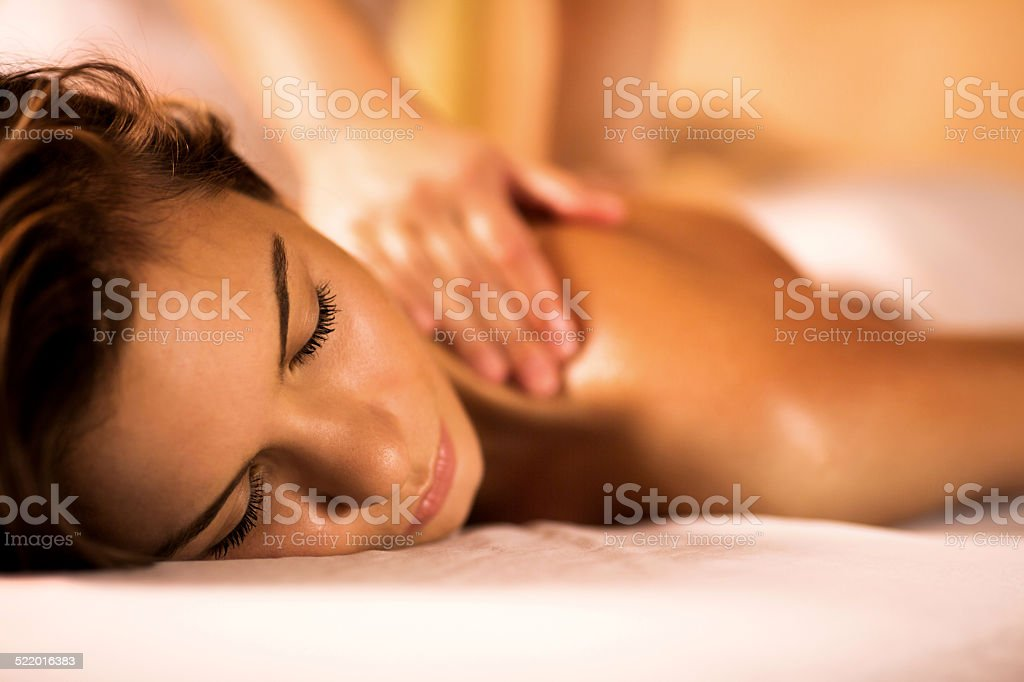 Woman receiving back massage. stock photo
