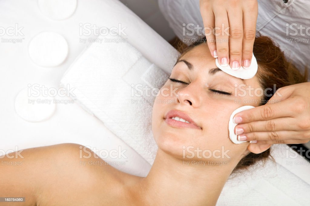 Woman receiving beauty treatment at wellness spa royalty-free stock photo