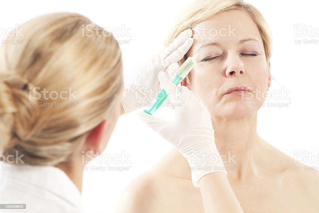Woman receiving Botox treatment royalty-free stock photo