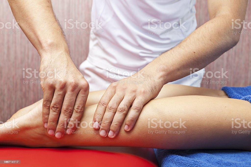 Woman Receiving Calf Massage royalty-free stock photo