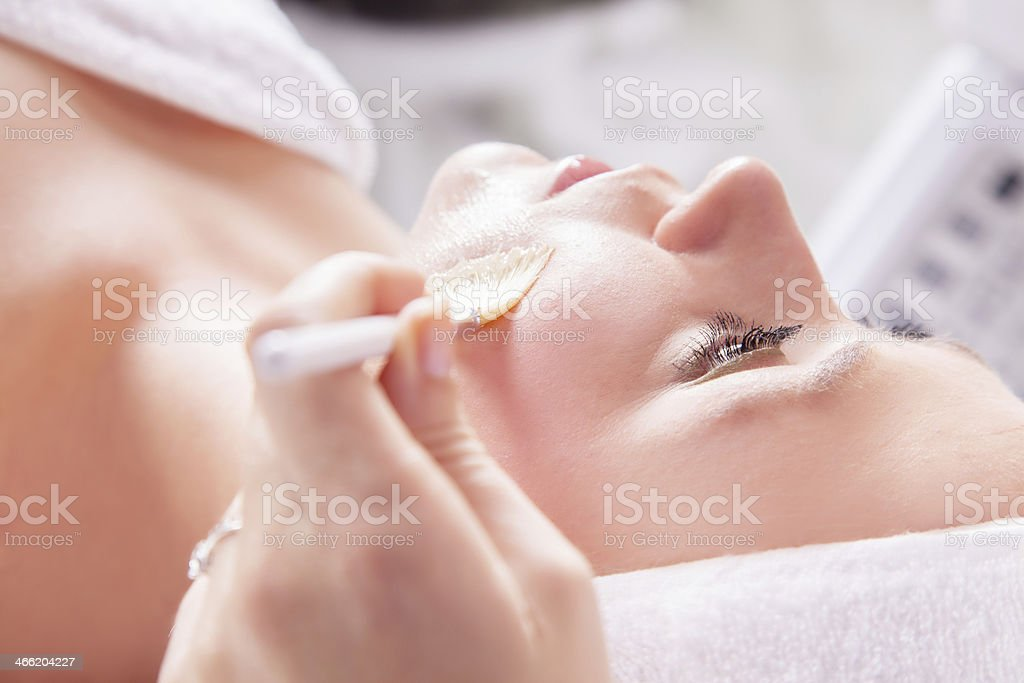Woman receiving cosmetic treatment stock photo
