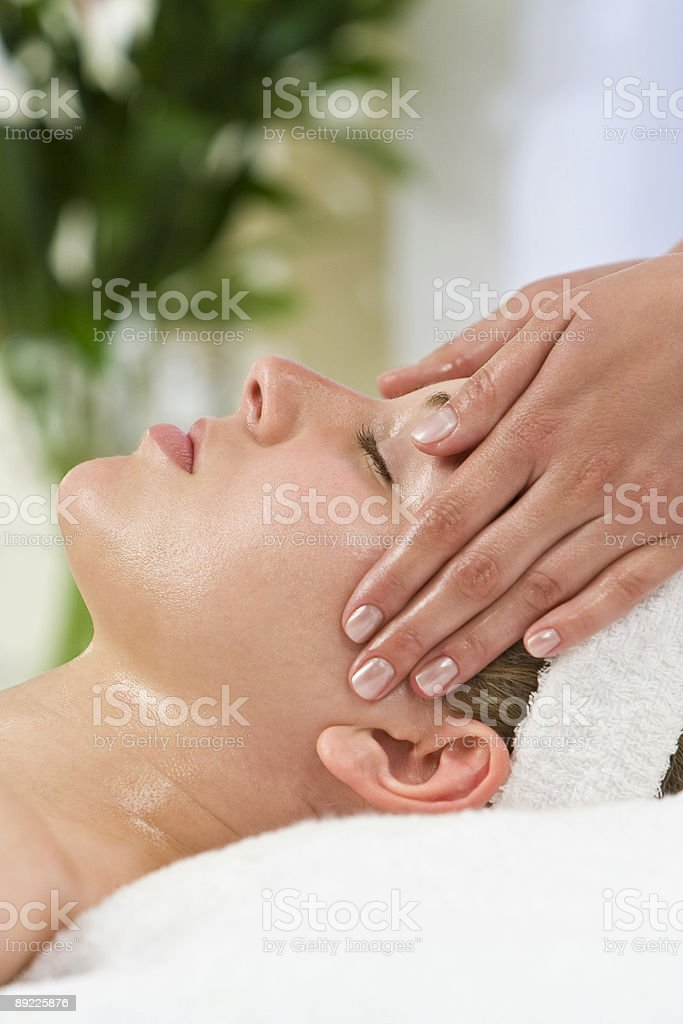 Woman Receiving De Stressing Relaxing Head Massage at Health Spa royalty-free stock photo