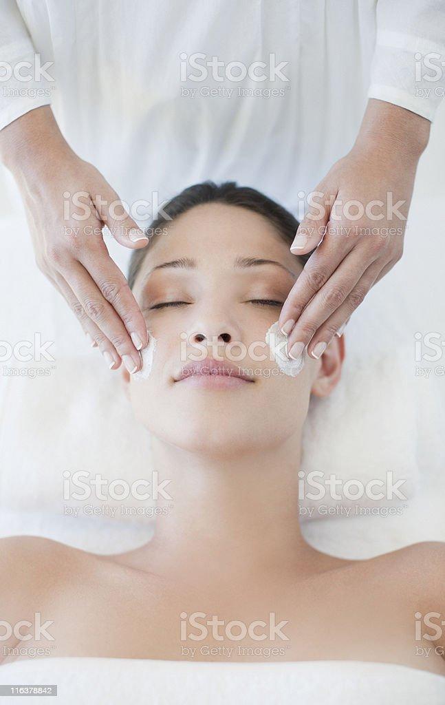 Woman receiving facial massage royalty-free stock photo
