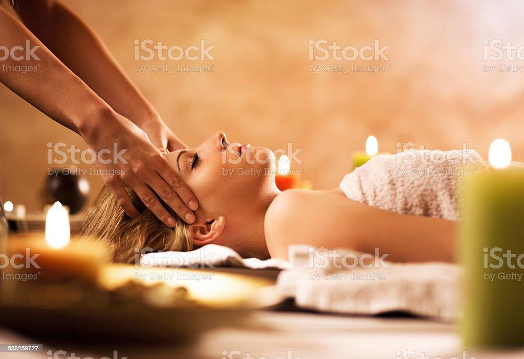 Woman receiving facial massage. stock photo