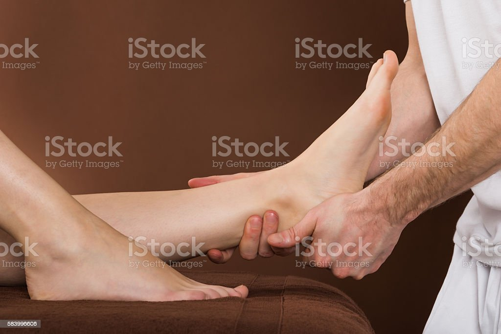 Woman Receiving Foot Massage At Spa stock photo