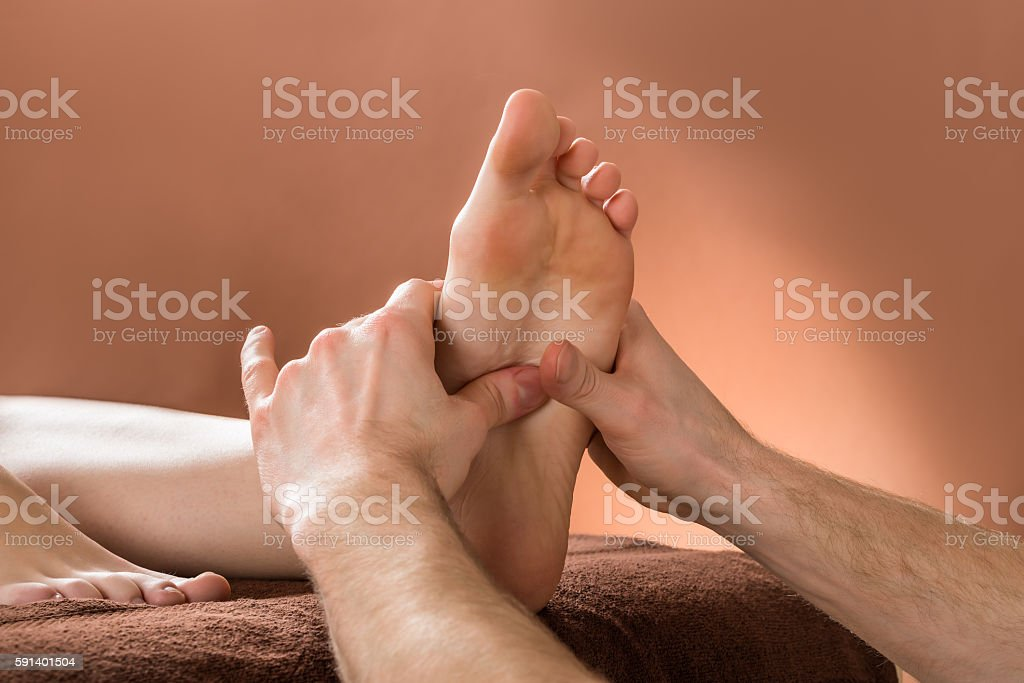 Woman Receiving Foot Massage stock photo